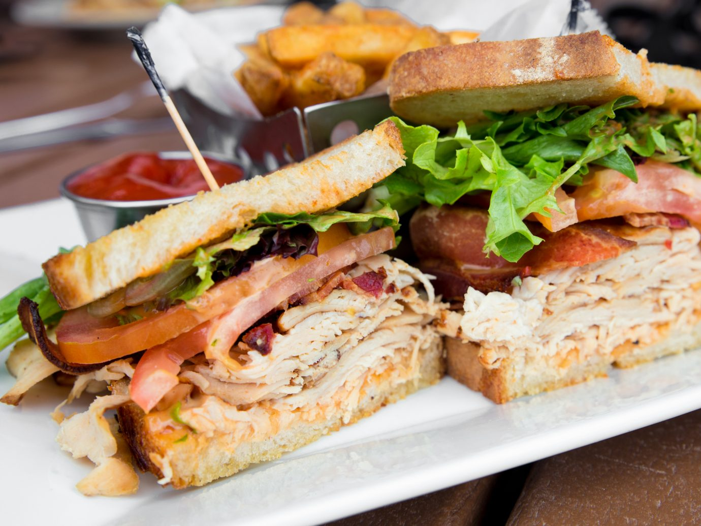 Delicious turkey club sandwich on toast with bacon, lettuce and tomato.