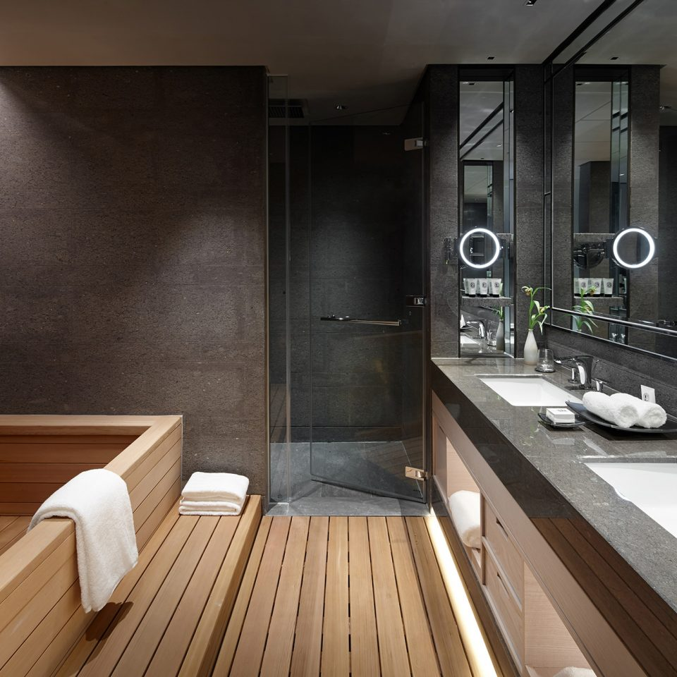 Korean suite with wooden flooring and tub