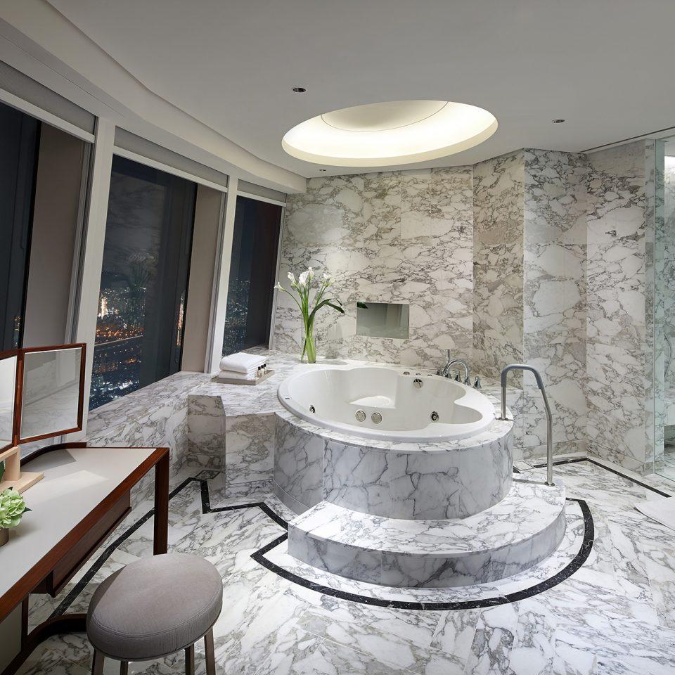 large marble-like bathroom in royal suite