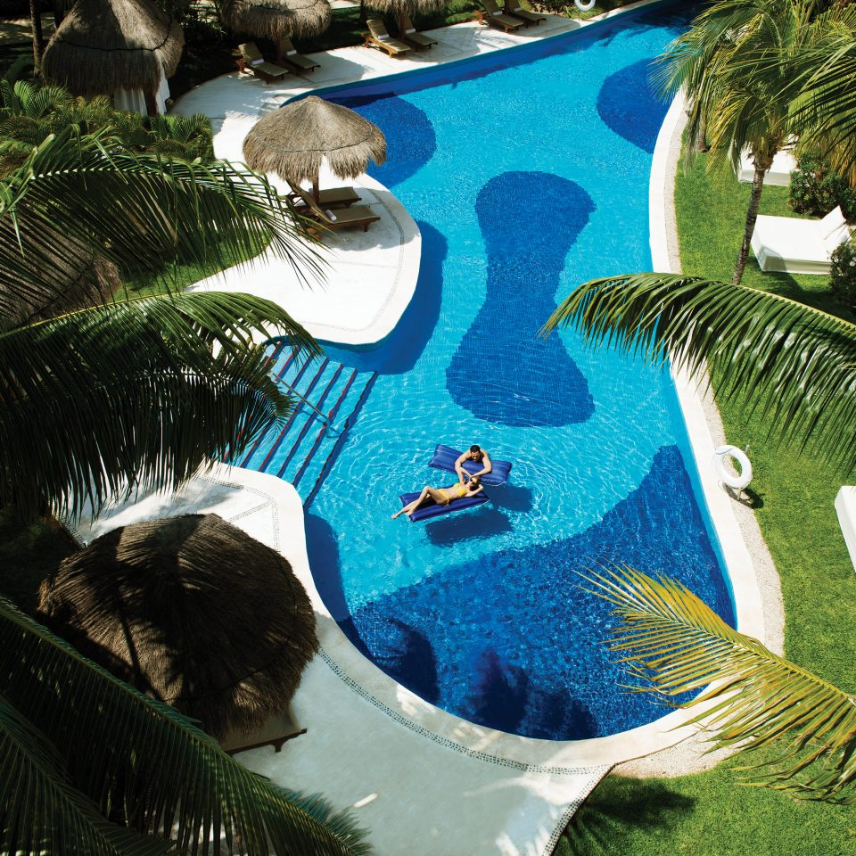overhead of people lounging in pool