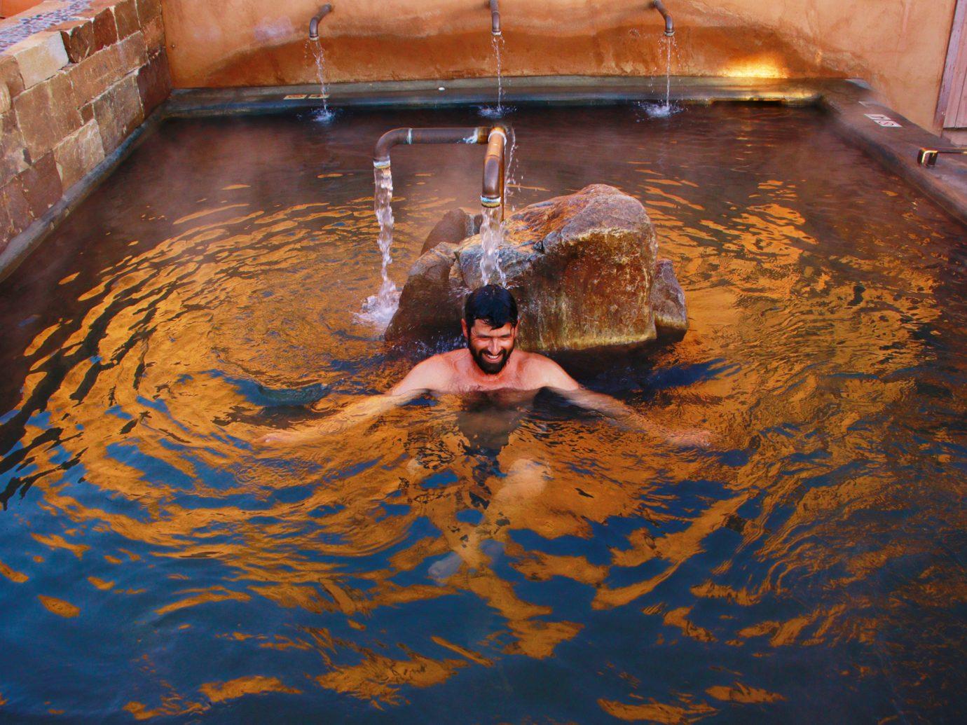 man in hot springs