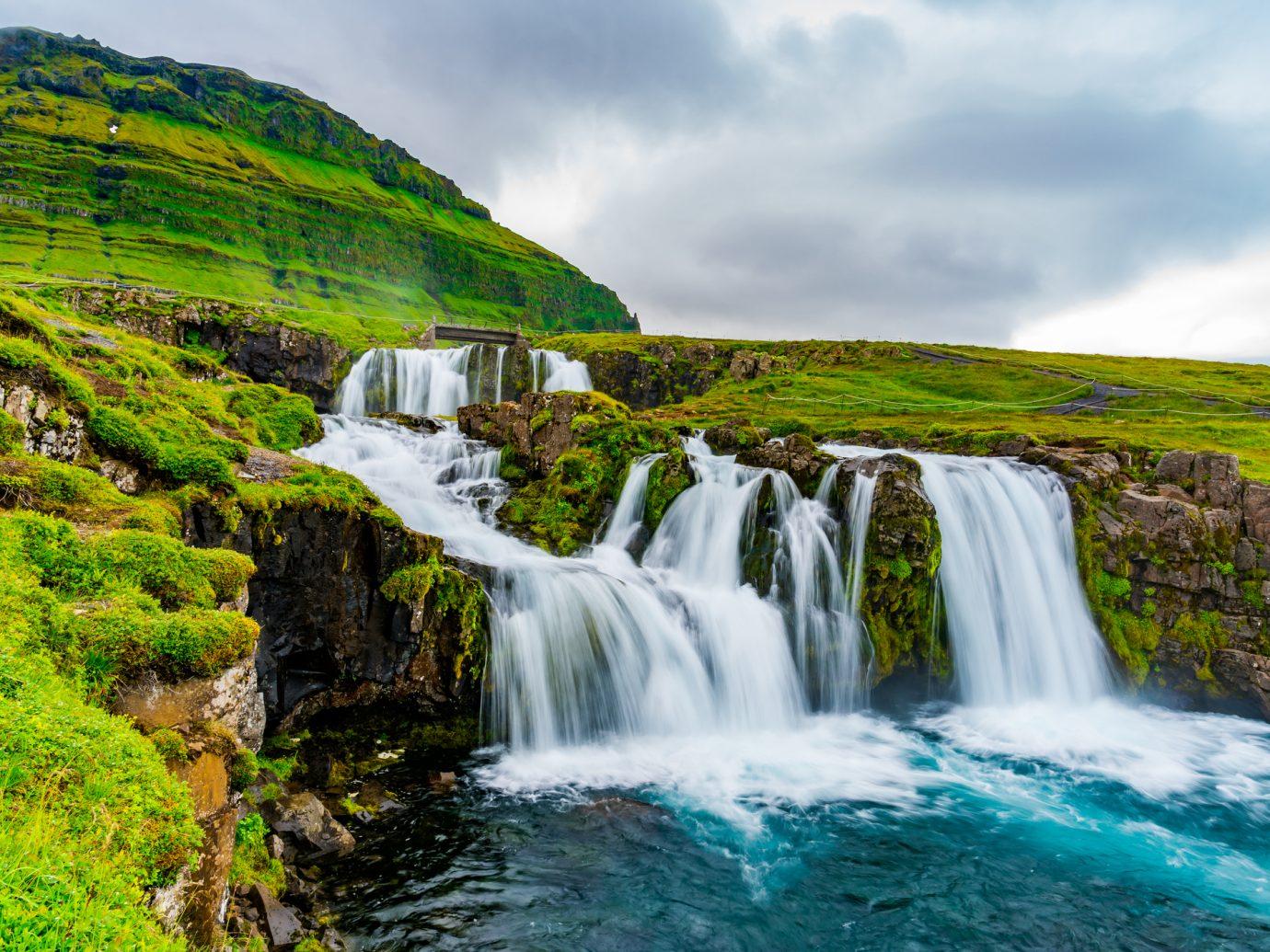 View of Kirkjufellsfoss Waterfalls at Kirkjufell Mountain in the summer rainy day at Grundarfjordur in West Iceland