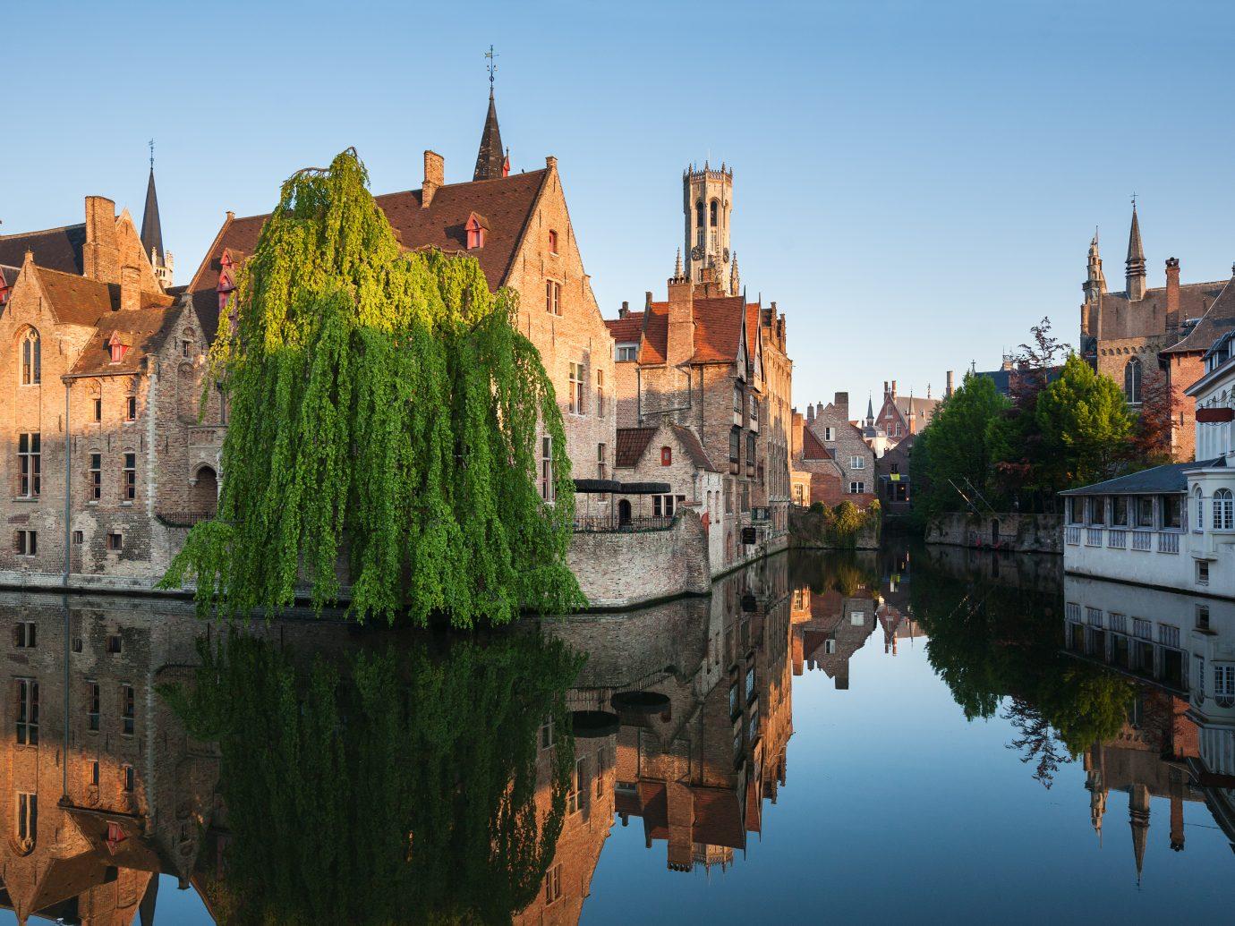 Rozenhoedkaai in Brugge, Dijver river canal twilight and Belfort tower.