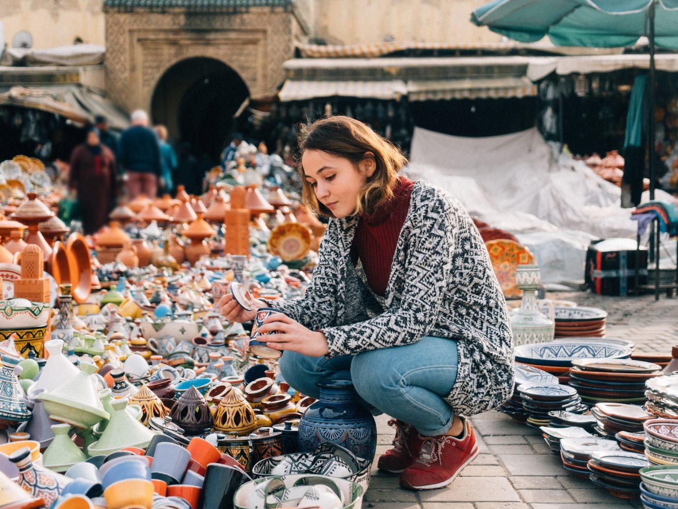 Young Caucasian woman choosing Ceramic in shop in Meknes, Morocco