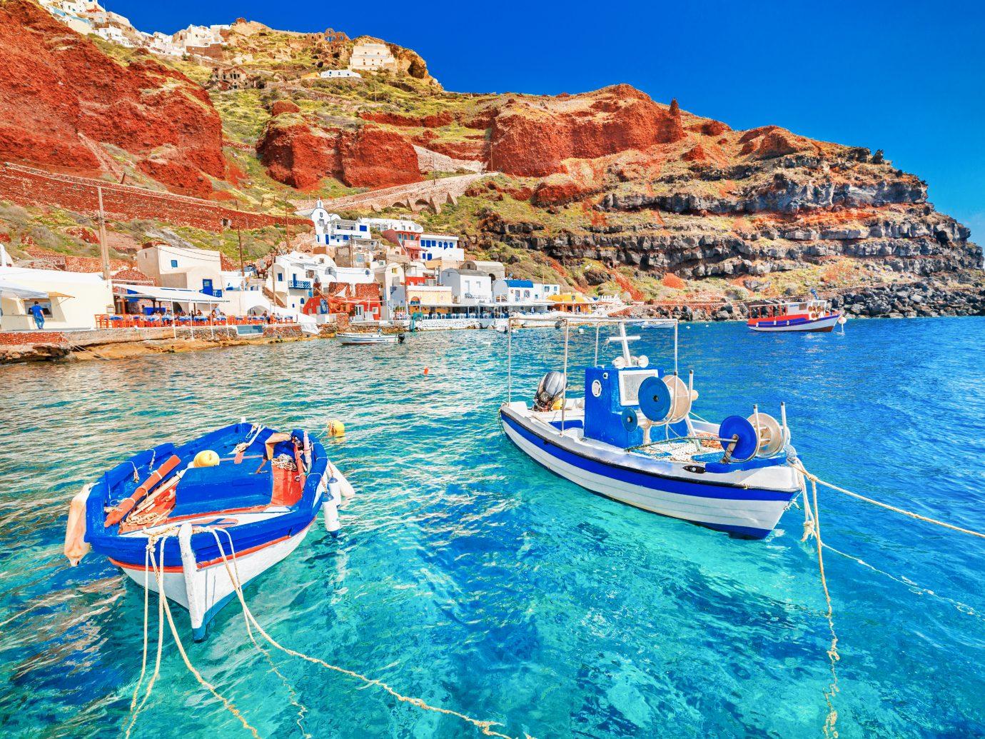 old port panorama in Oia Ia village on Santorini Greek island in Aegean sea.