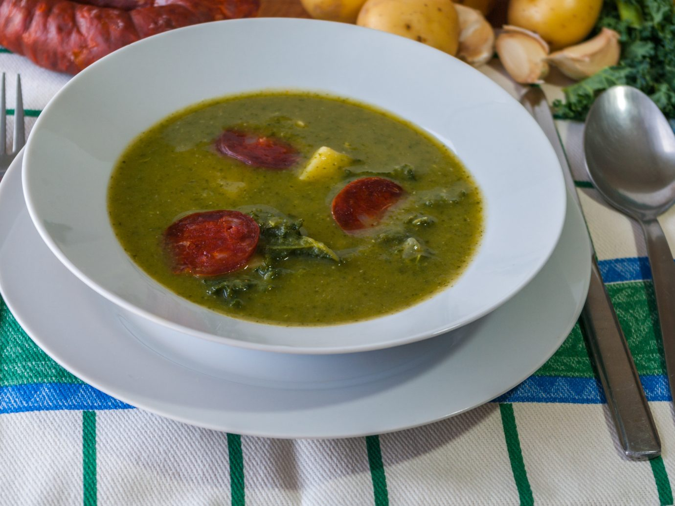 Caldo Verde - traditional Portuguese green soup made with kale, potatoes, onion, garlic and chorizo