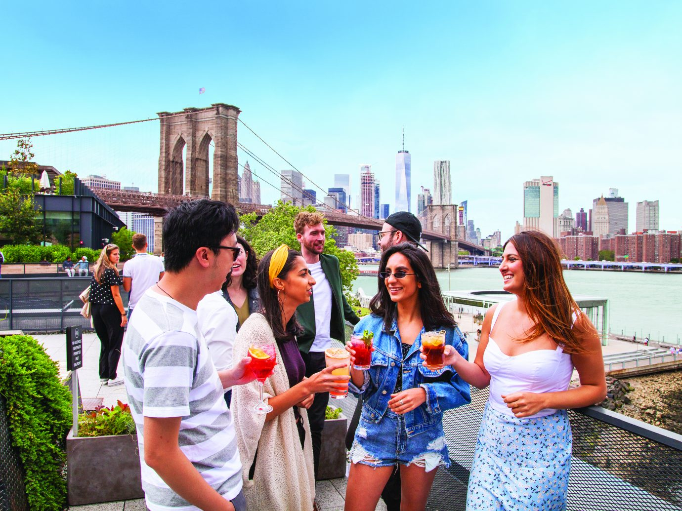 People drinking at the Time Out Market New York Rooftop