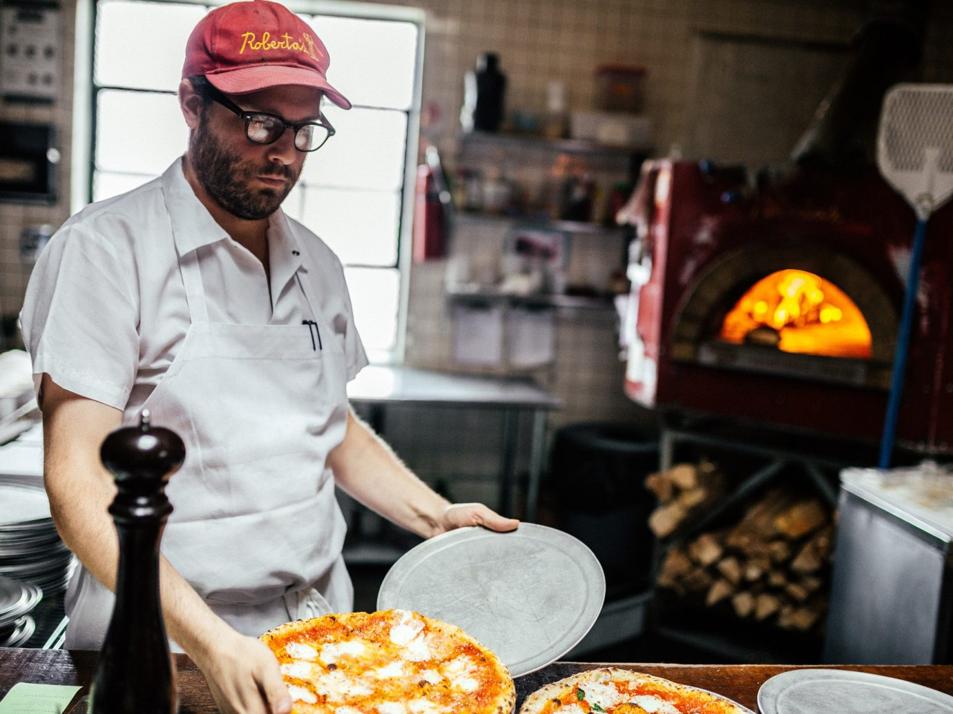 Person making pizza at Roberta's