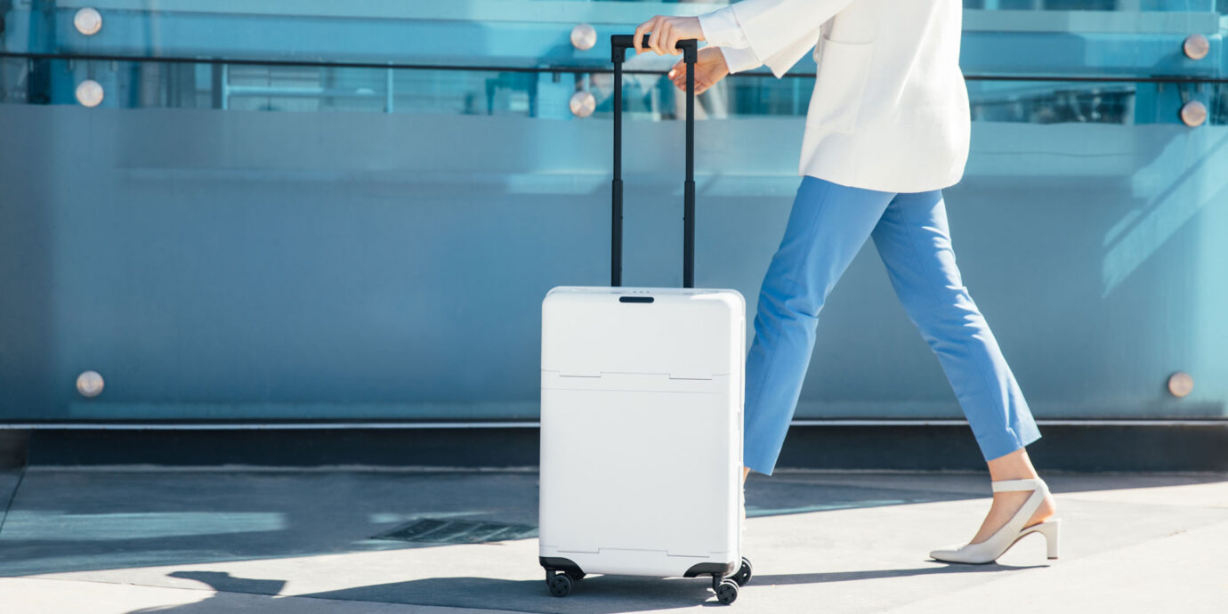 Woman traveling with carry-on suitcase