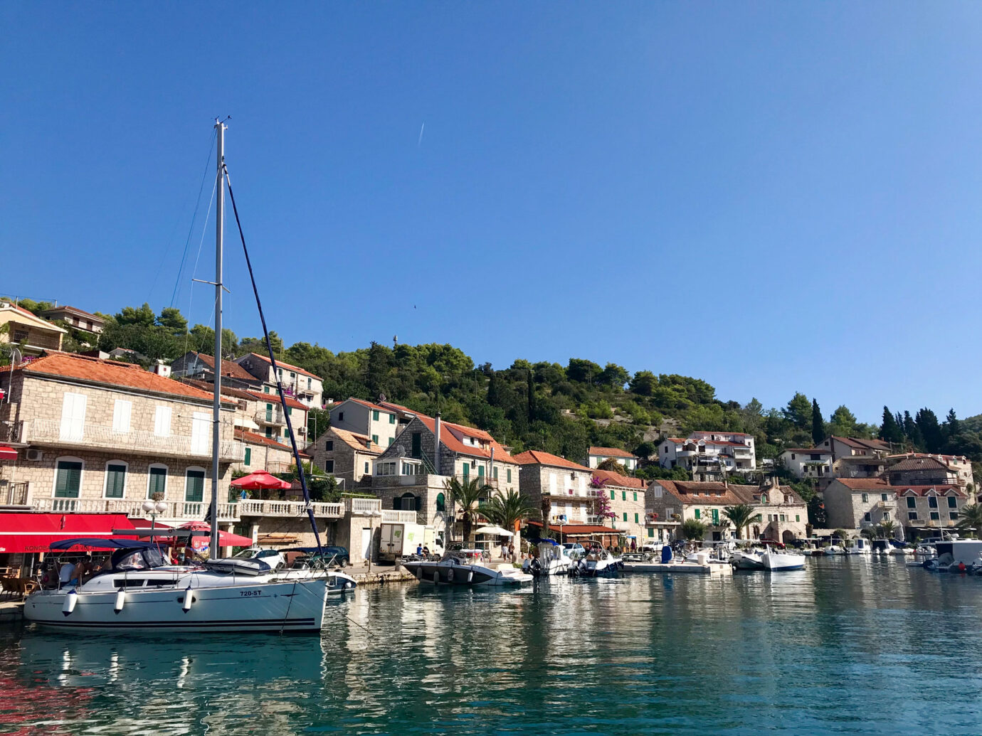 boats along the shore on the coast of Šolta, Croatia