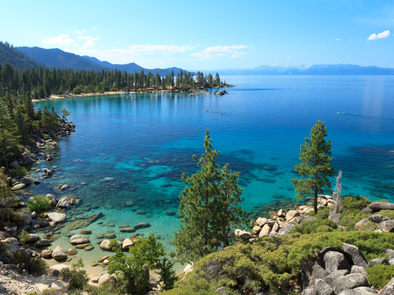 Picture of Lake Tahoe seeing from view point near Sand Harbor. This is east shore line with many rocks and pine trees photographed in the morning during summer.