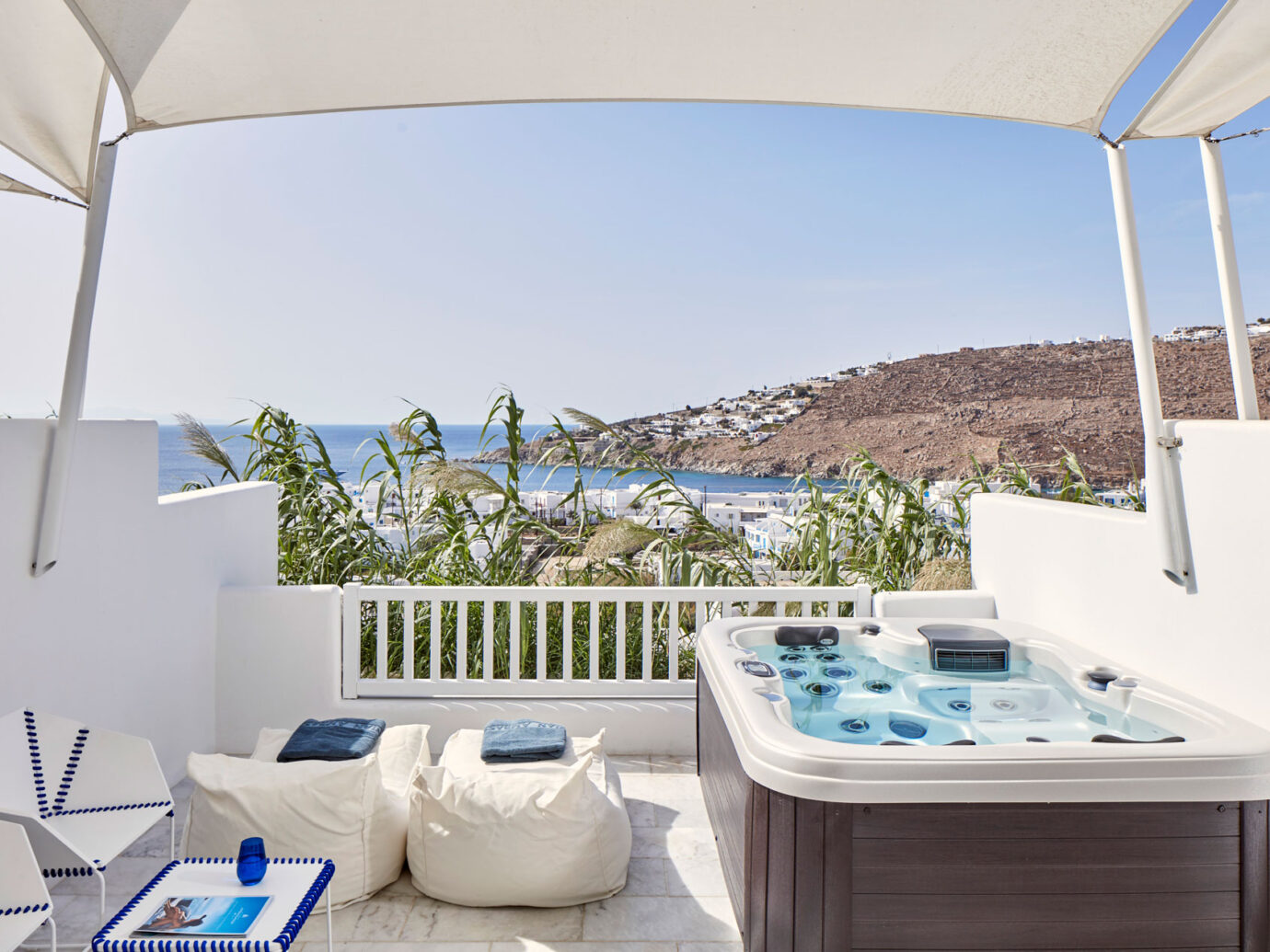 outdoor hot tub and ocean view from Myconian Ambassador Hotel