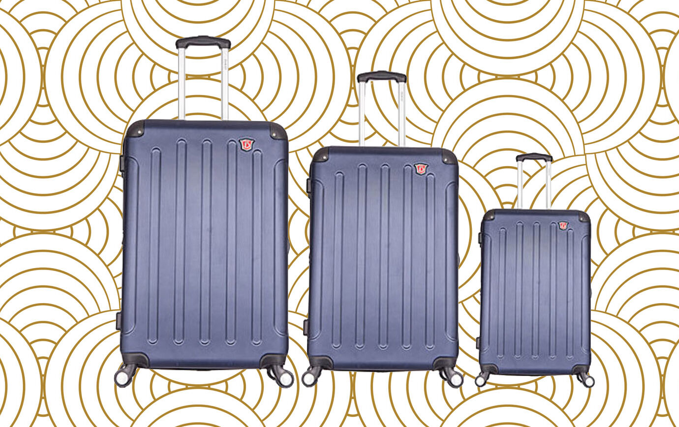 The 10 Best Luggage Sets Under $400, Young woman travelling in New York with suitcase