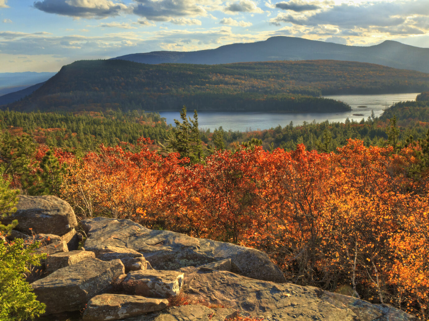 """Afternoon sun on sunset rock in the Autumn, overlooking North-South Lake in the Catskills Mountains of New York."