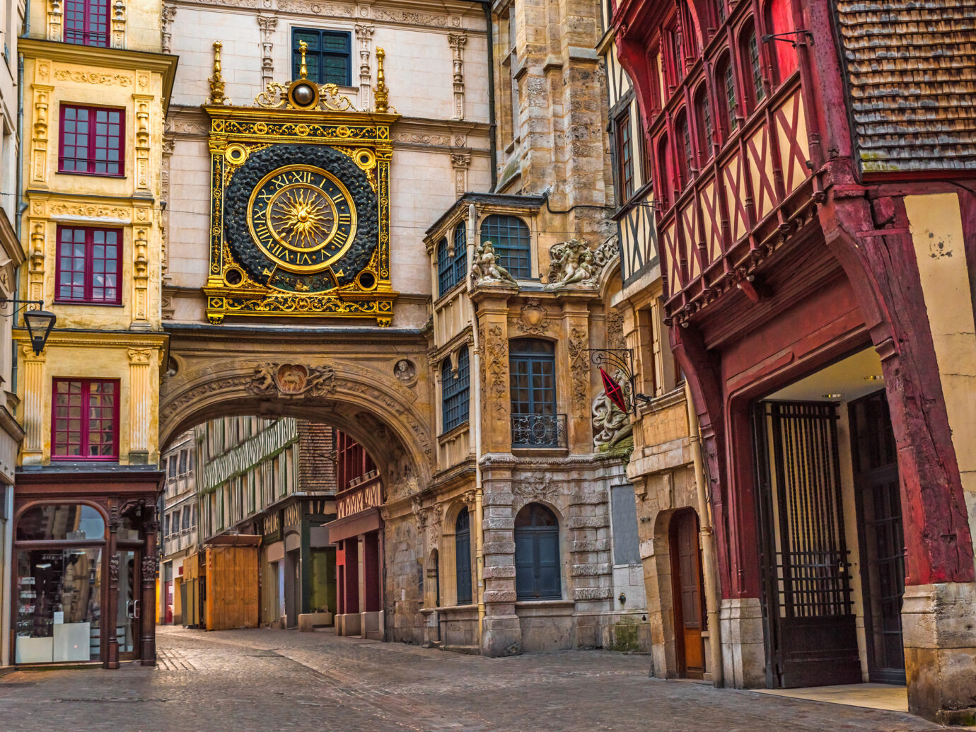 Old cozy street in Rouen with famos Great clocks or Gros Horloge of Rouen, Normandy, France with nobody