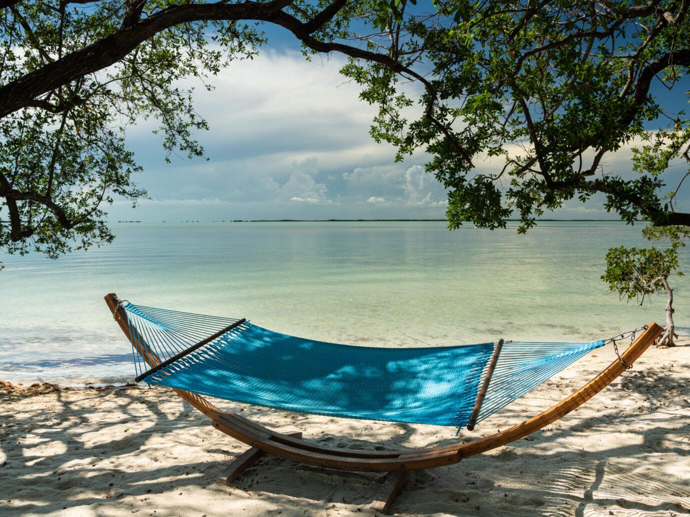 Hammock by the beach at Baker's Cay Resort