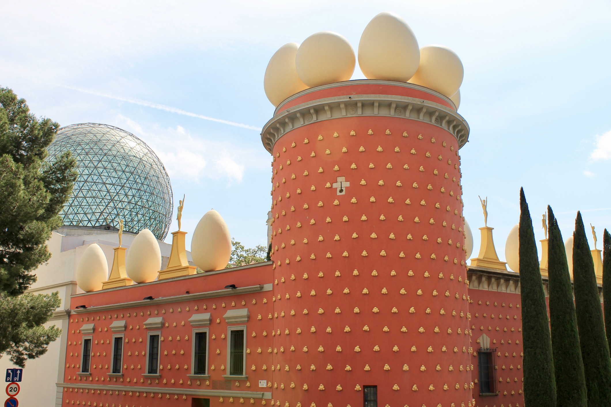 The Dali Theatre and Museum is a museum of the artist Salvador Dali in his home of Figueres. There is a crypt below the stage where the famous artist is buried. It is one of the most popular museums in Spain, consistently receiving over a million visitors. Perhaps the most famous aspect of the building is the series of giant eggs that surround the edge of the roof.