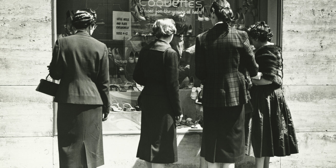 old fashioned photo of people window shopping
