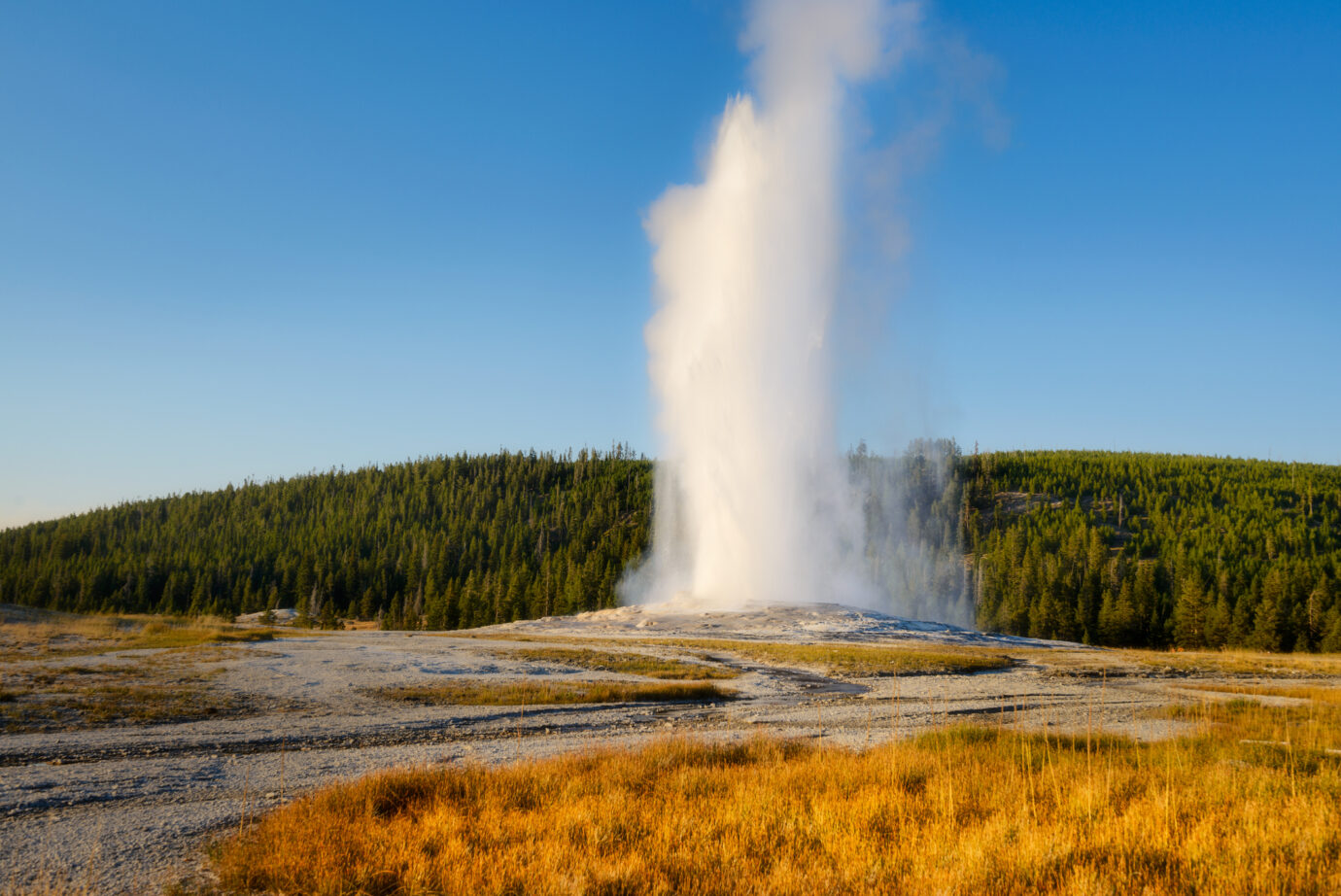 Hot spring explosion. Old Faithful Geyser, Yellowstone National Park, Wyoming, USA