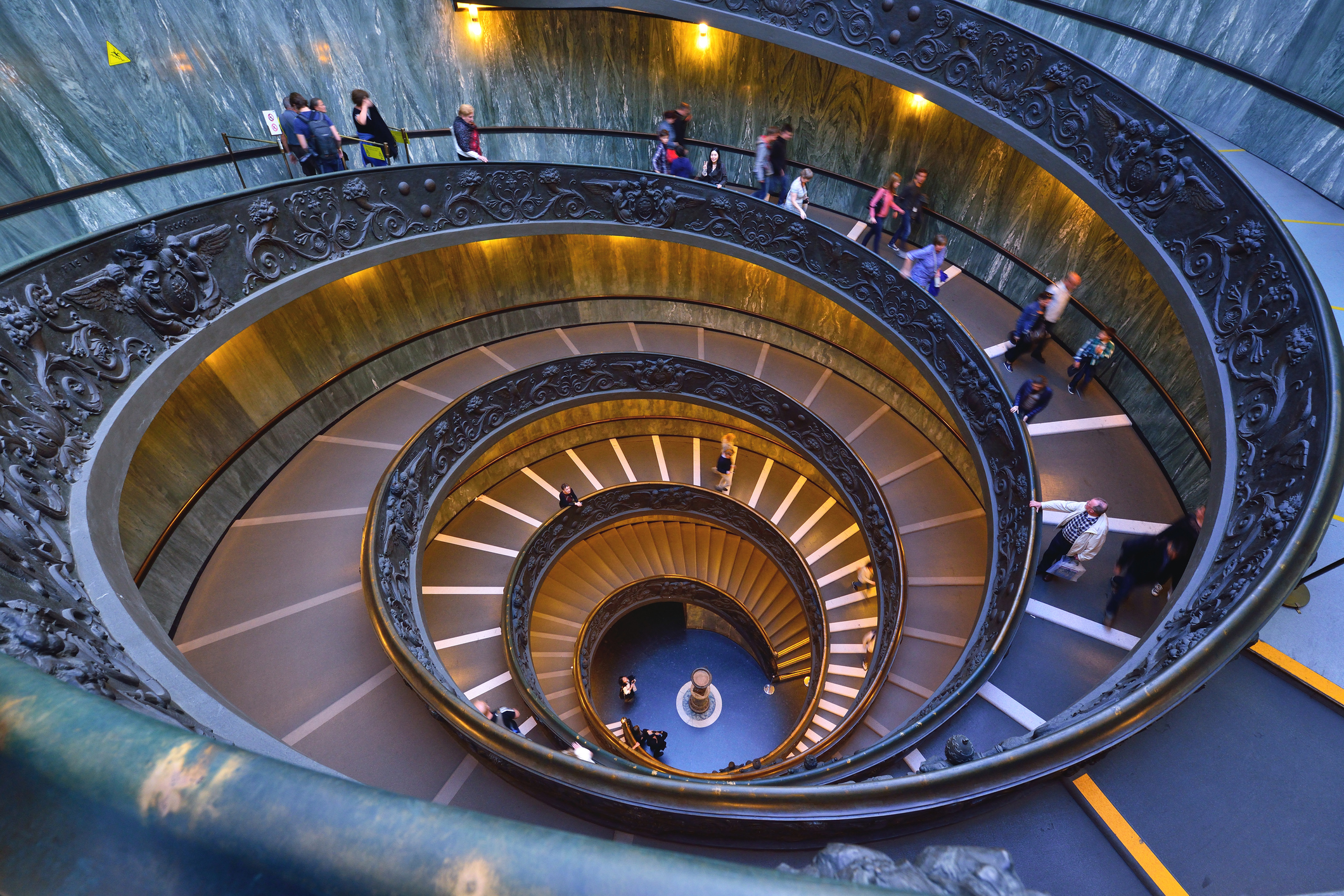 The famous and old spiral staircase. that leads to the exit of the vatican museum inside the vatican city. The Vatican Museums are among the greatest museums in the world.