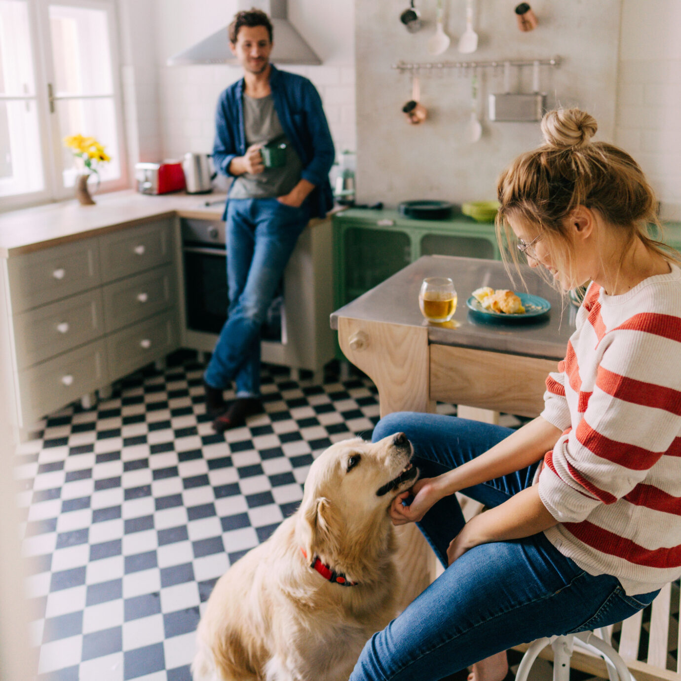 Couple drinking together in the kitchen