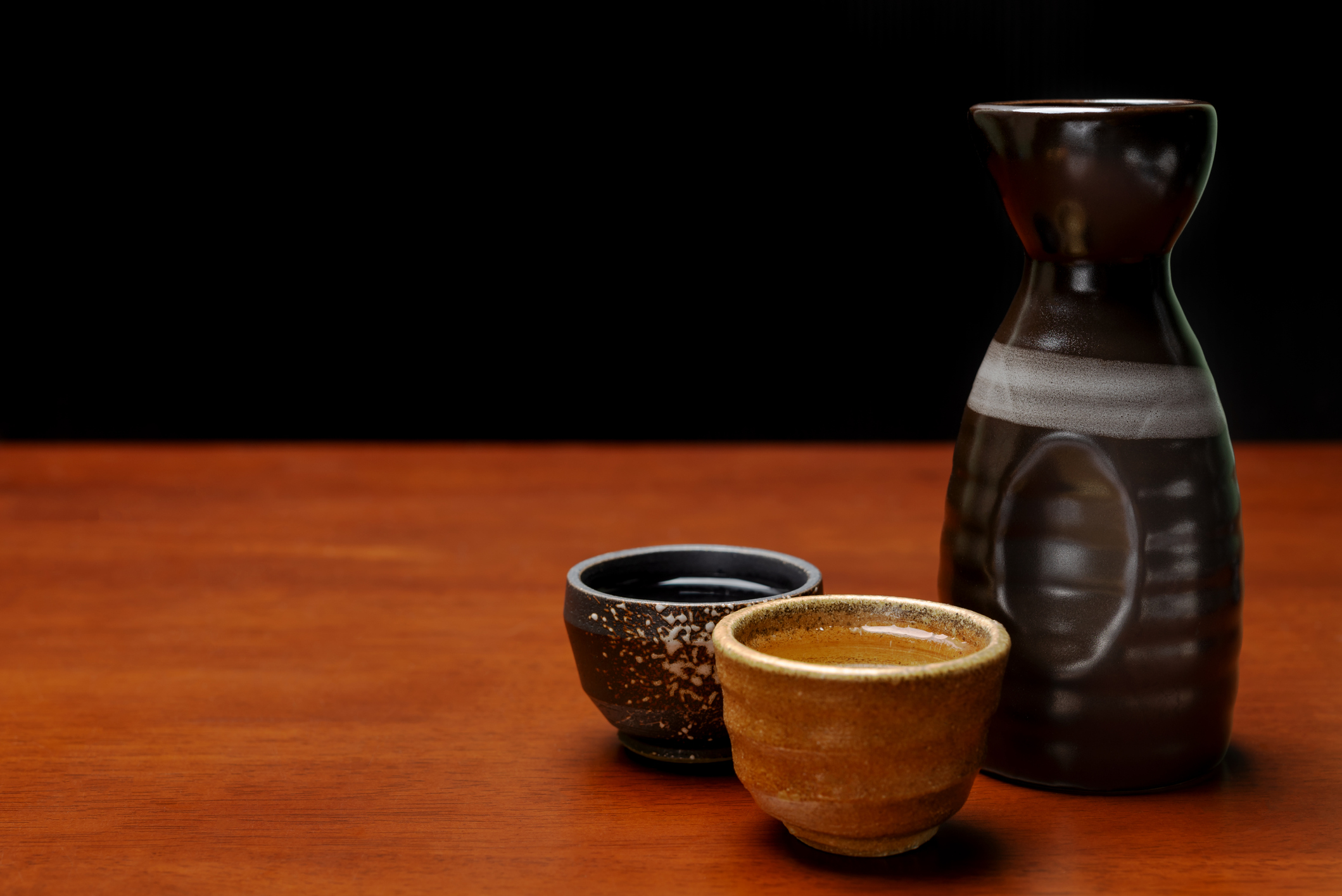 many sake cup and bottle with copy space