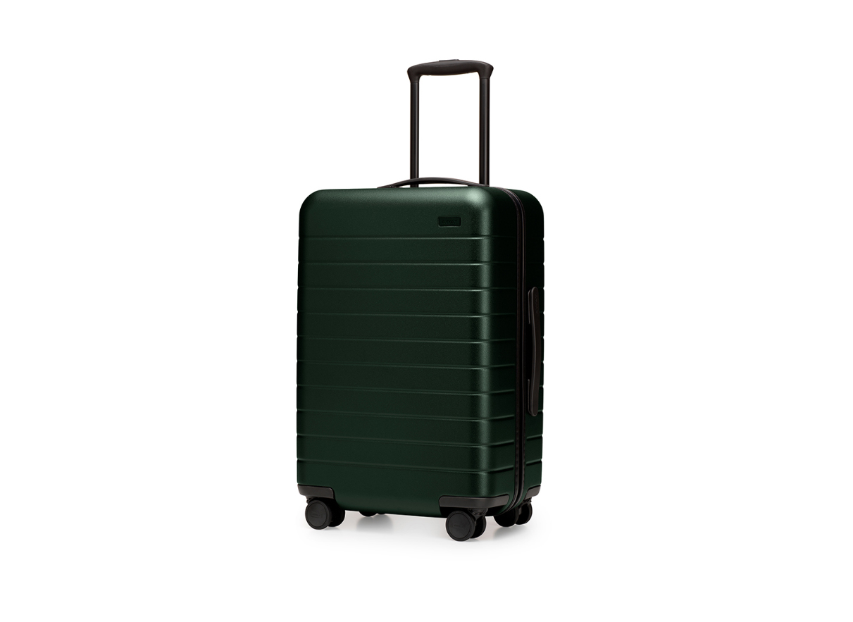 Away suitcase, the bigger carry-on in green