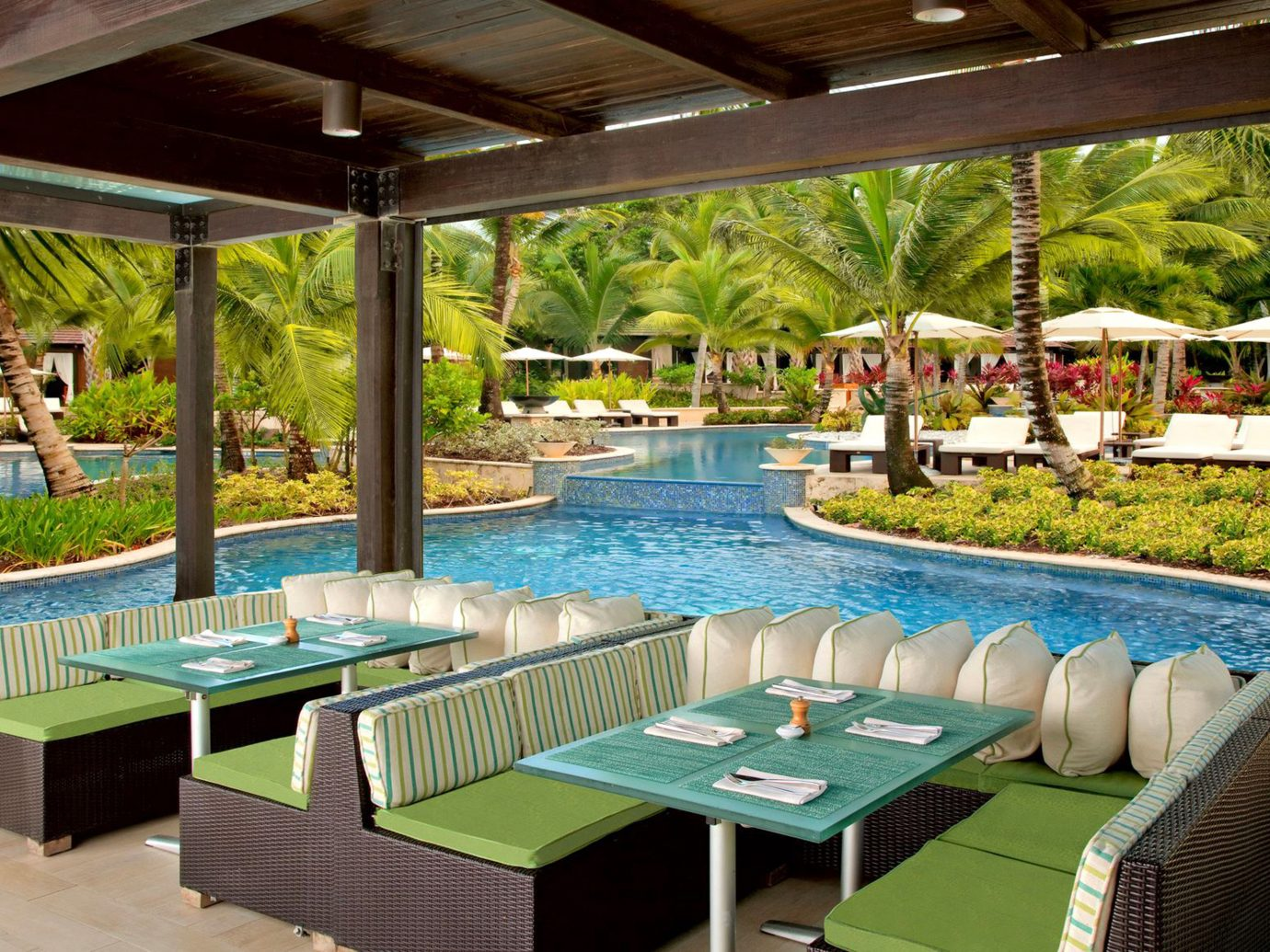 Dining Drink Eat Hotels Luxury Play Pool Resort Trip Ideas table leisure property outdoor swimming pool estate backyard Villa real estate eco hotel restaurant outdoor structure Deck porch set