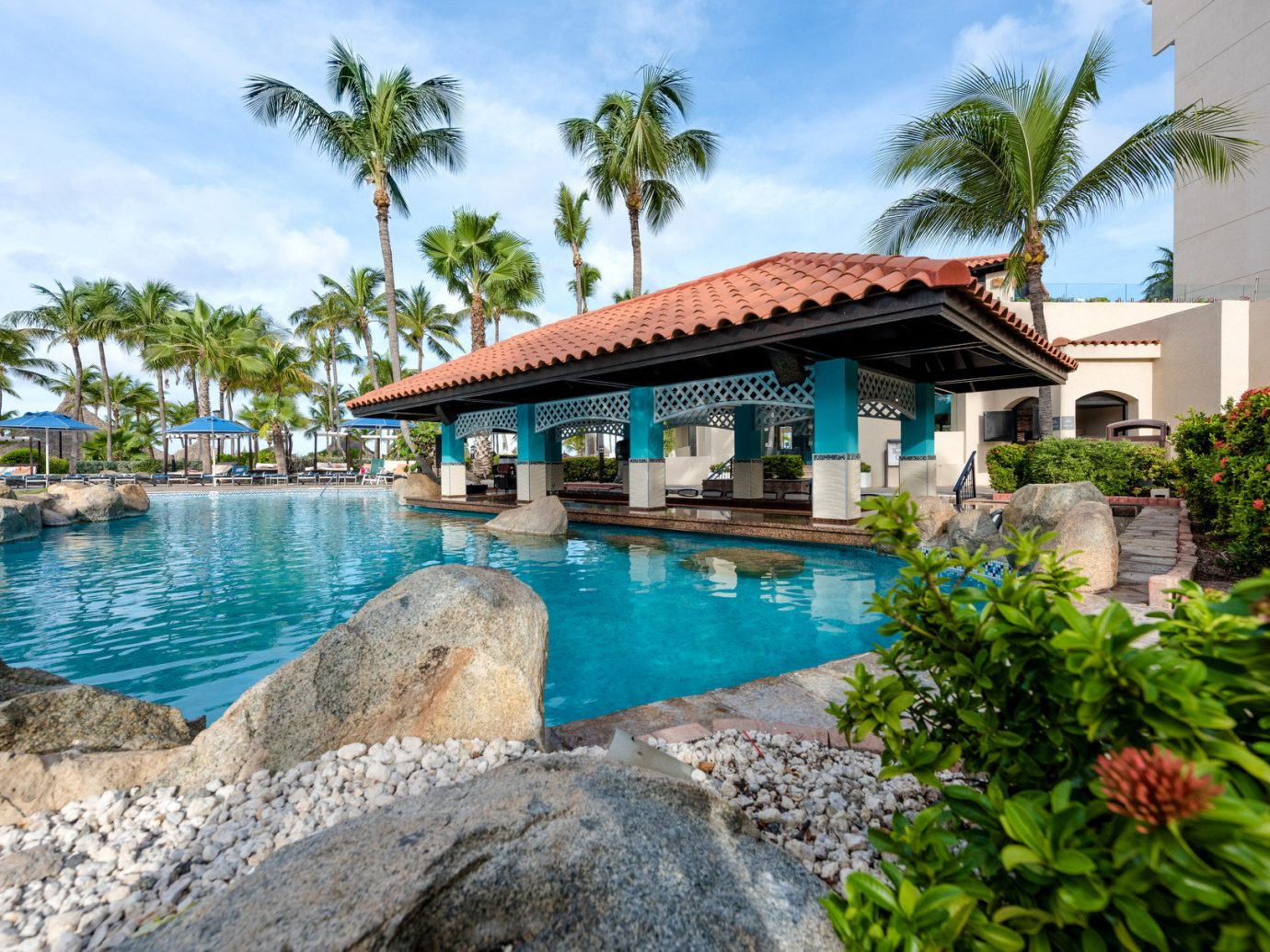 Hotels outdoor tree sky building water rock house property Pool Resort estate vacation swimming pool tourism home Villa mansion Village stone swimming Garden