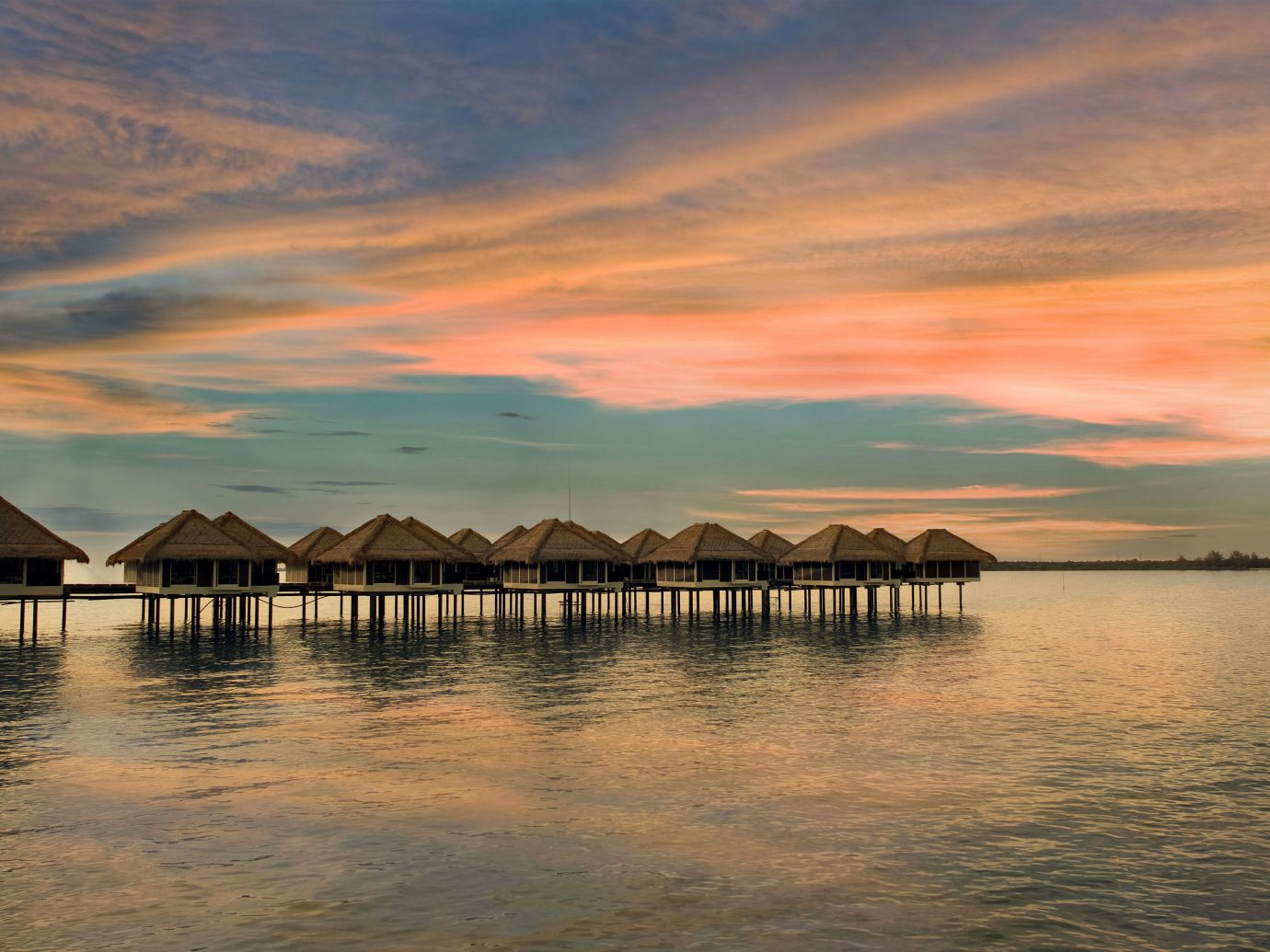 Island Luxury Overwater Bungalow Romance Romantic Sunset Trip Ideas Waterfront water sky outdoor scene pier shore sunrise cloud Sea reflection horizon body of water dawn Ocean dusk evening afterglow morning Coast Beach loch Lake bay wave several