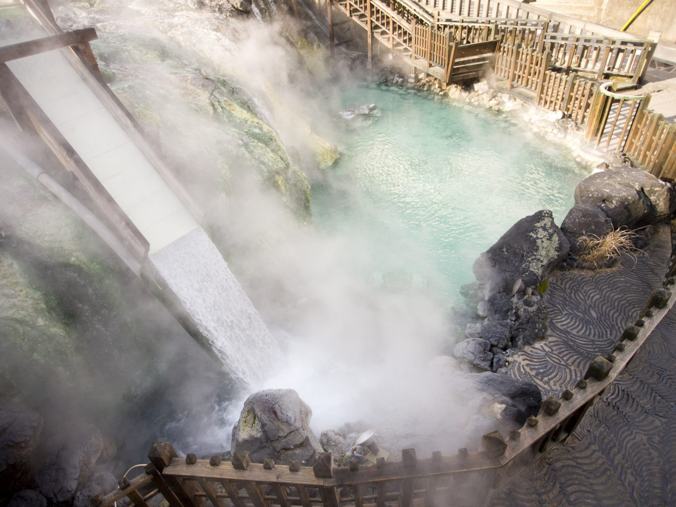 Day Trips water body of water fire smoke water resources outdoor water feature watercourse hot spring steam stack