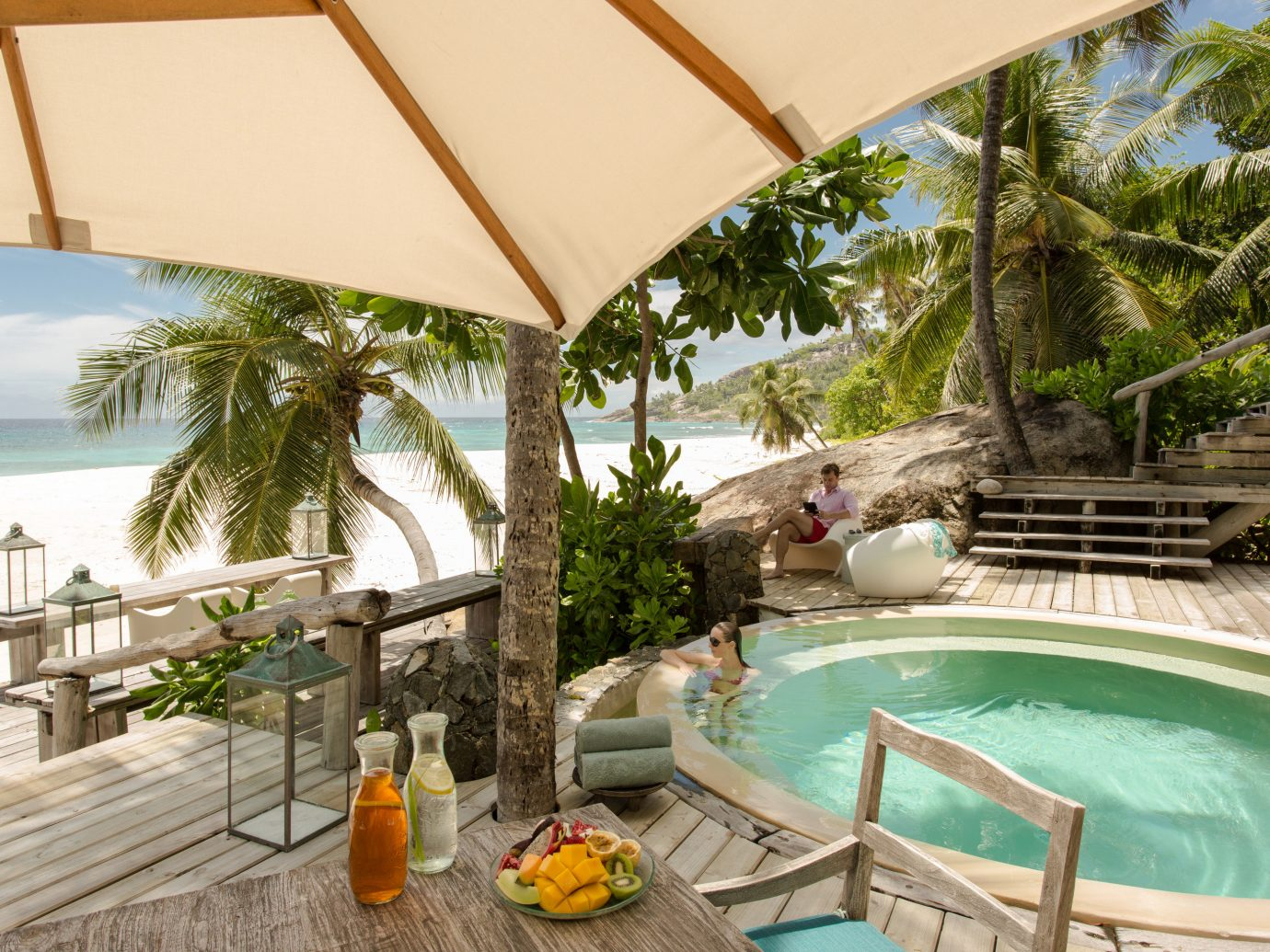 Luxury Travel Trip Ideas tree building Resort property swimming pool estate real estate arecales palm tree vacation leisure Villa outdoor structure hacienda resort town tropics caribbean furniture area Deck decorated wood Garden