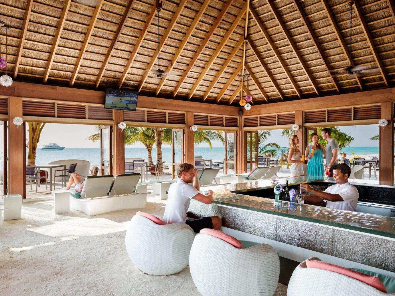 Budget indoor property Resort room estate vacation interior design home Villa cottage living room roof furniture several