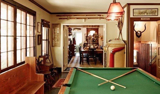 Outdoors + Adventure pool table poolroom indoor floor pool ball wall recreation room billiard room room table green estate interior design furniture