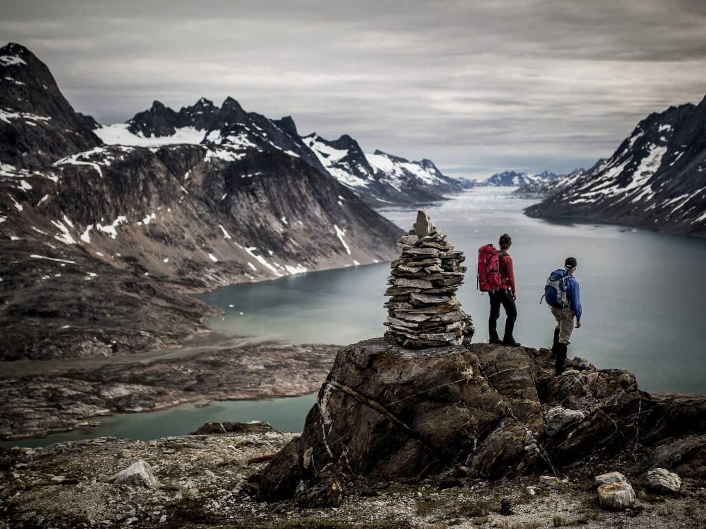 Hikers overlook the sound near Tiniteqilaaq in East Greenland