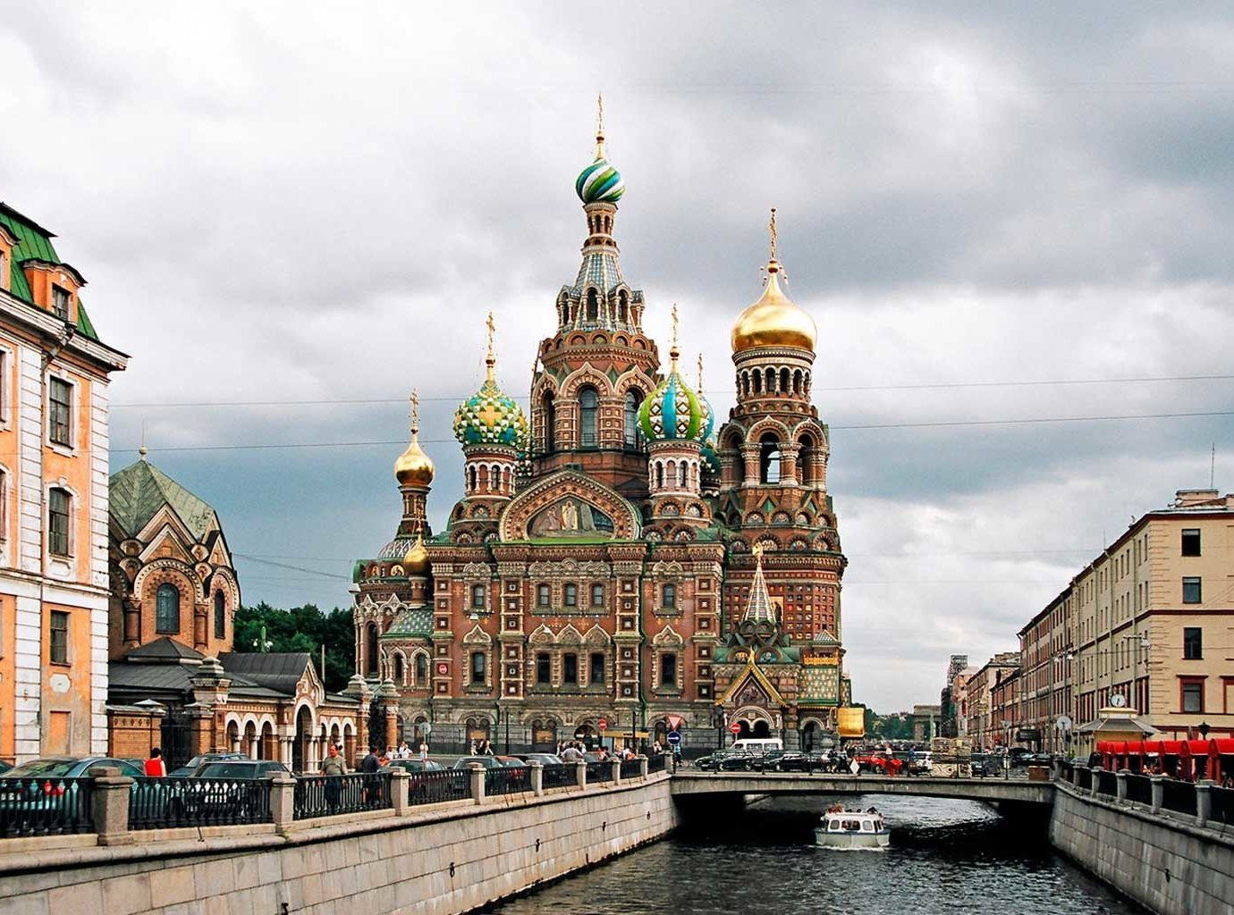 Architecture Buildings Cultural Drink Eat Exterior Hotels Luxury Travel Romance Shop outdoor sky building landmark Town City cityscape urban area tourism River waterway cathedral place of worship Church tower town square travel