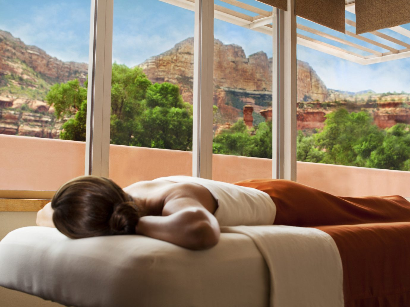 Greenery Hotels Jetsetter Guides Luxury Travel massage Mountains people relaxation remote retreat Rocks Spa treatment trees Trip Ideas view Weekend Getaways windows woman indoor sofa window mountain room property interior design home estate real estate window covering condominium overlooking