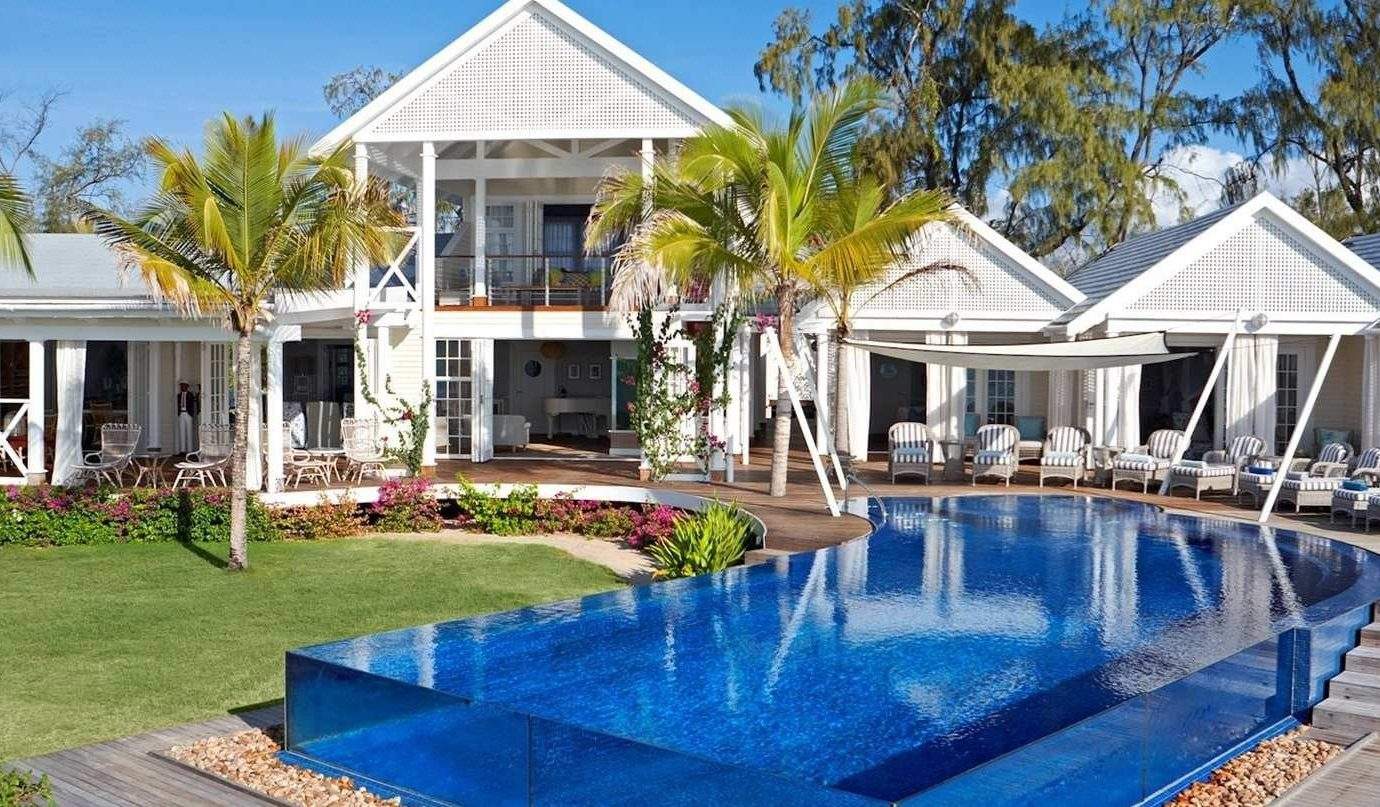 Honeymoon Hotels Luxury Travel Romance tree outdoor building grass house property home estate real estate swimming pool Resort mansion Villa leisure cottage blue Pool backyard facade window landscaping residential Garden