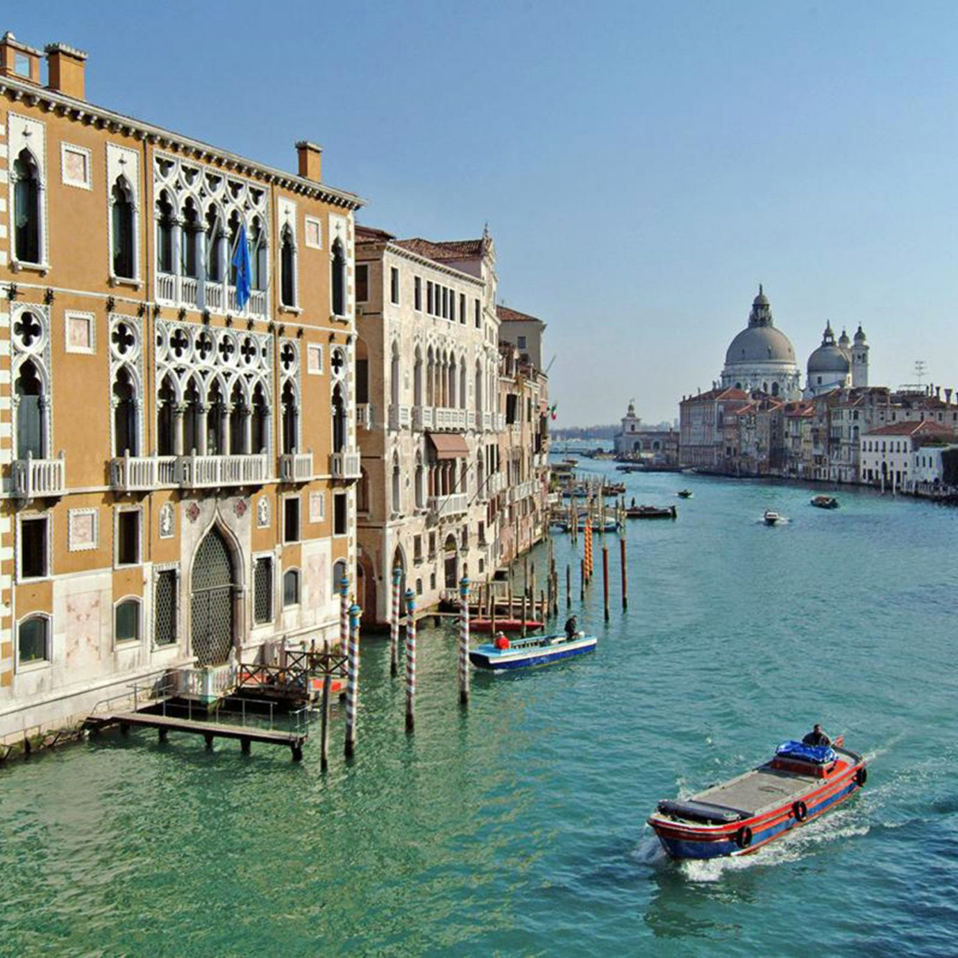 Hotels Italy Luxury Travel Trip Ideas Venice water sky Boat outdoor Canal landform geographical feature body of water Town waterway vehicle vacation River tourism channel gondola Sea cityscape Harbor traveling