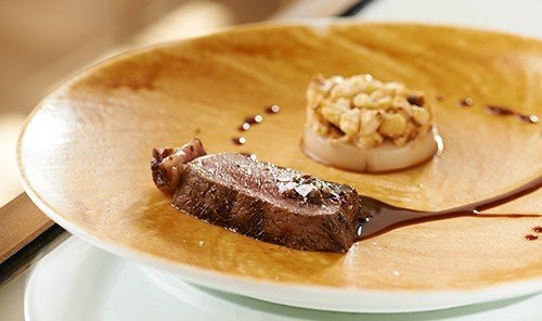 Food + Drink plate table dish food chocolate breakfast meal piece meat cuisine produce dessert slice sliced