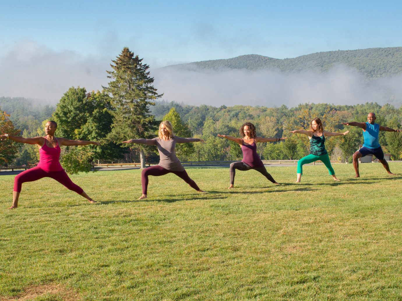 Health + Wellness Meditation Retreats Spa Retreats Trip Ideas Yoga Retreats grass sky outdoor human action field sports physical fitness Sport physical exercise