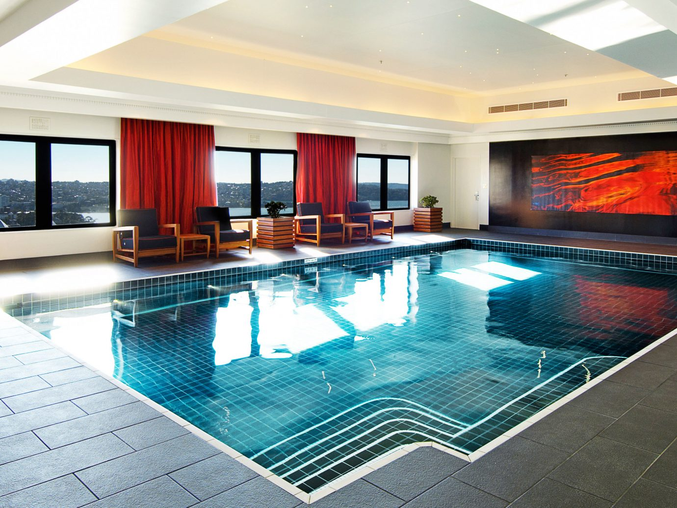 Hotels Living Lounge Luxury Pool indoor floor ceiling swimming pool property room window leisure estate real estate Resort interior design home condominium furniture Villa