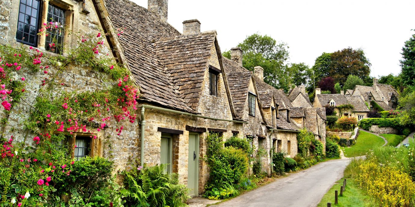 Trip Ideas cottage Village house Town home flower estate rural area almshouse tree sky real estate facade medieval architecture plant grass manor house farmhouse