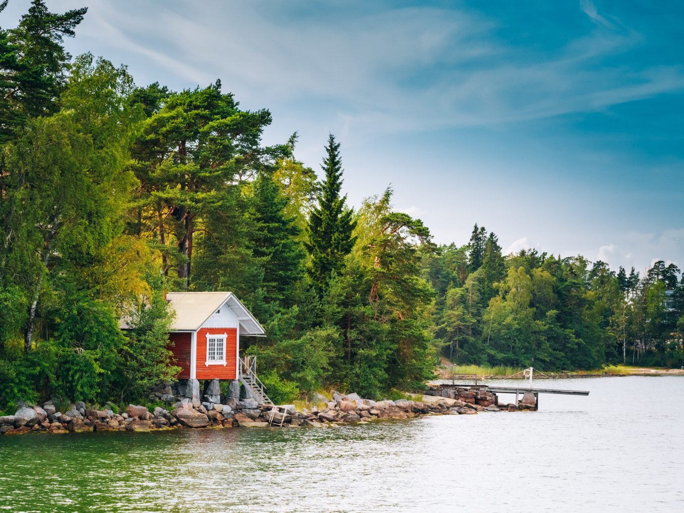 Offbeat Travel Tips tree outdoor water sky Boat Nature Lake River body of water shore vacation vehicle reflection rural area landscape Sea surrounded waterway Forest traveling wooded land several