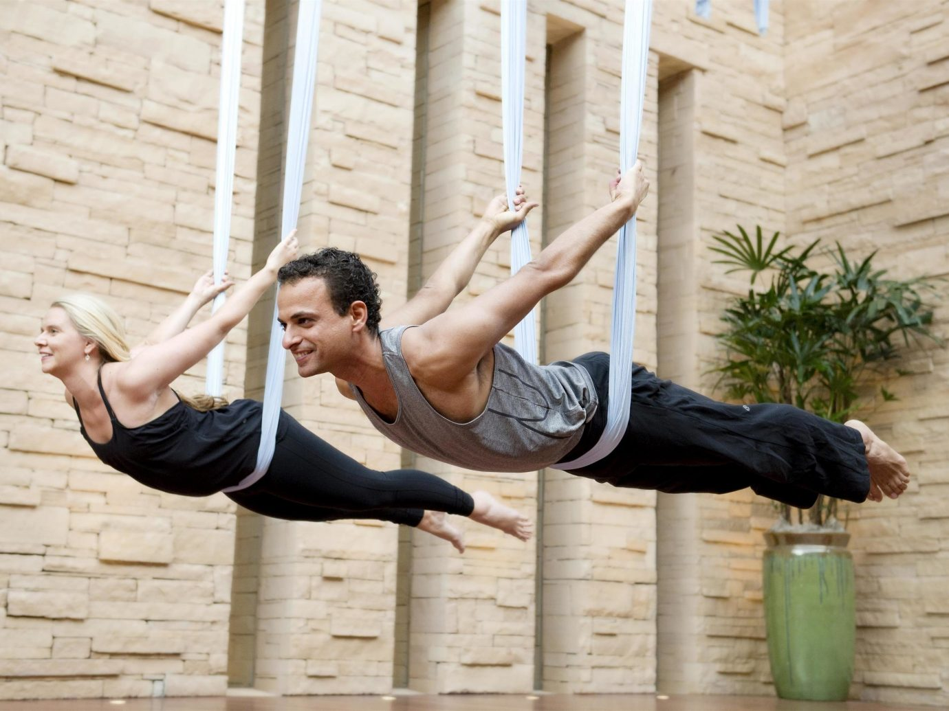 Health + Wellness Hotels Yoga Retreats person building outdoor human action sports human positions physical fitness arm sitting yoga modern dance reaching physical exercise
