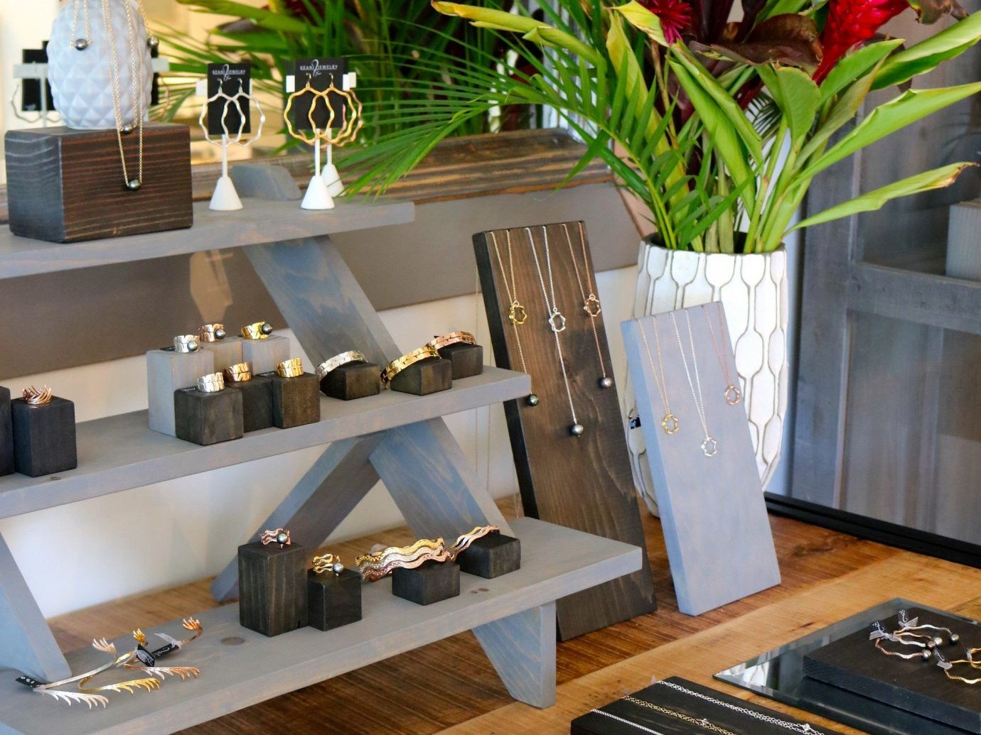 Trip Ideas indoor table wall plant furniture interior design houseplant living room cluttered