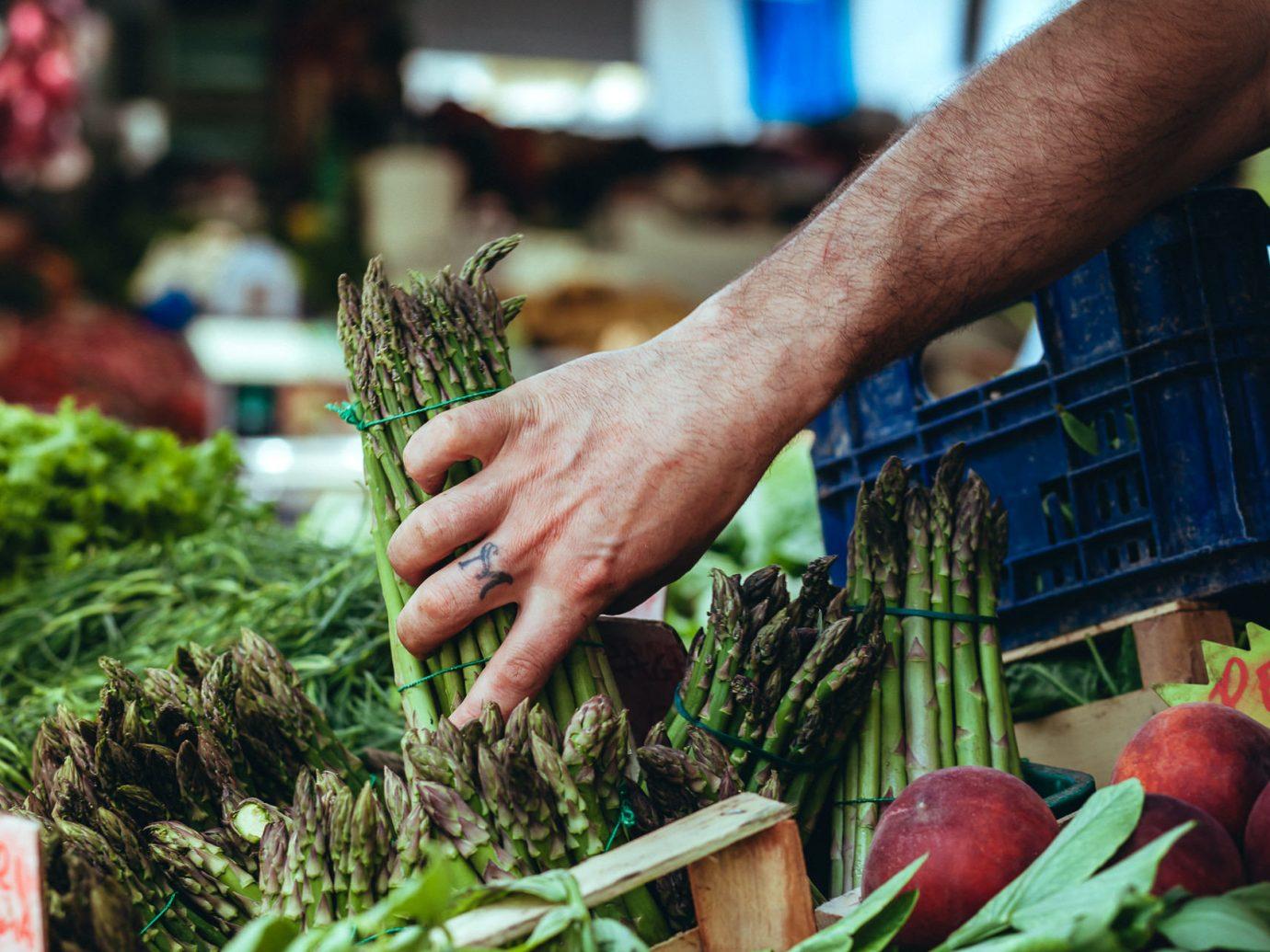 Food + Drink person local food City public space vegetable market human settlement food floristry produce vendor sense plant fresh asparagus