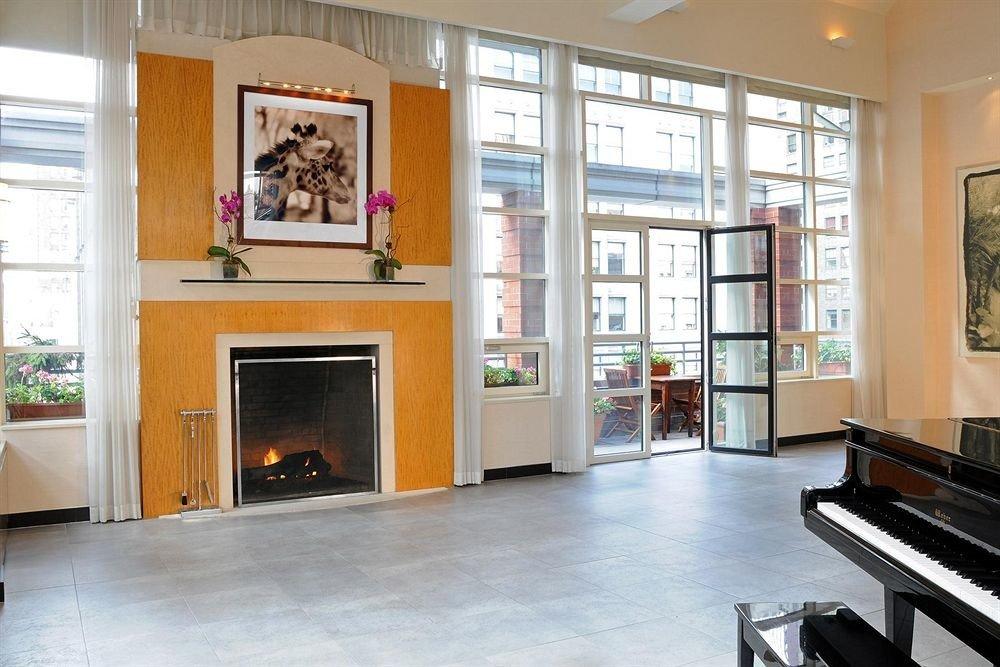 Hotels indoor floor property room ceiling Living living room home cabinetry hardwood interior design real estate estate Design flooring area furniture wood