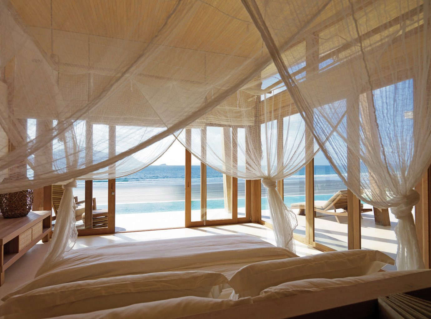Beach Beachfront Bedroom Eco Elegant Forest Hotels Jungle Luxury Mountains Ocean Patio Scenic views Secret Getaways Trip Ideas Villa Waterfront indoor bed chair property room house Architecture estate wood interior design home daylighting ceiling Design Resort