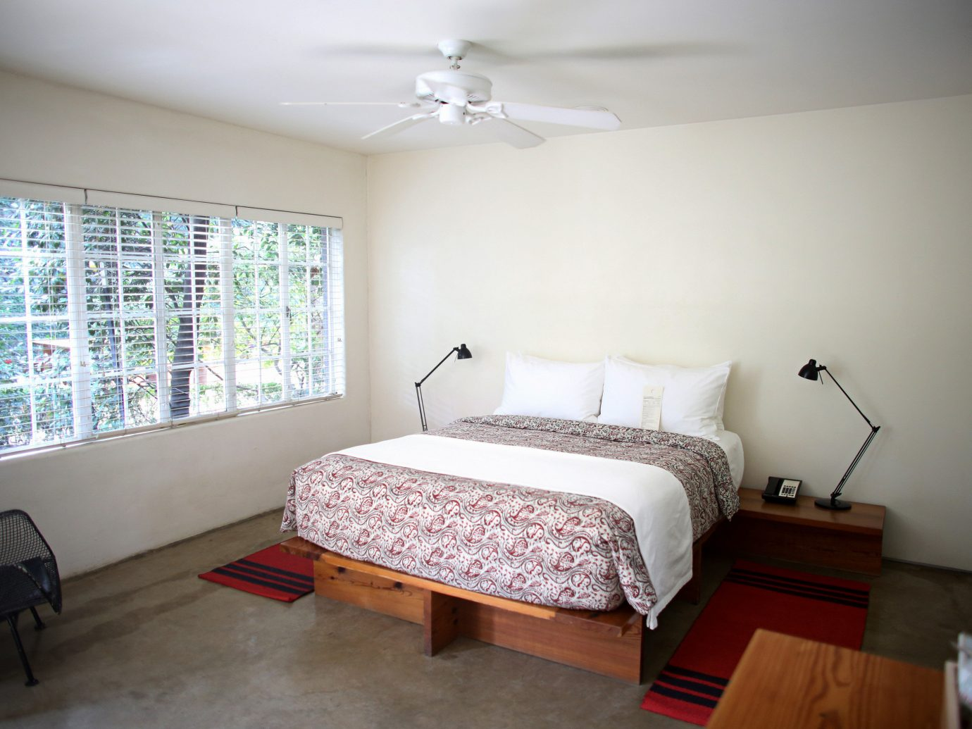 Bedroom Design Hip Hotels wall indoor floor room ceiling property bed real estate cottage estate home interior design condominium apartment living room furniture area wood